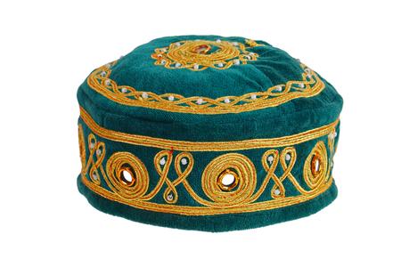 skullcap: Green skullcap embroidered on a white background