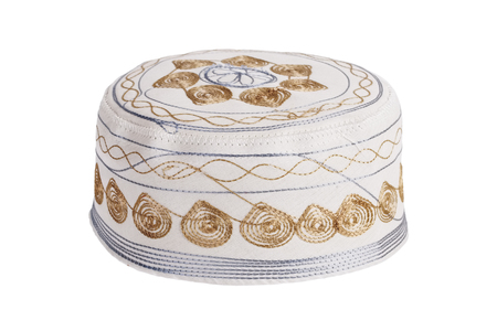 skullcap: White skullcap embroidered on a white background Stock Photo