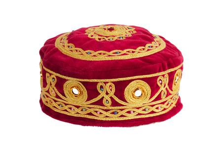 skullcap: Red round skullcap on a white background