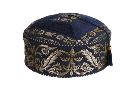 skullcap: Blue round skullcap on a white background