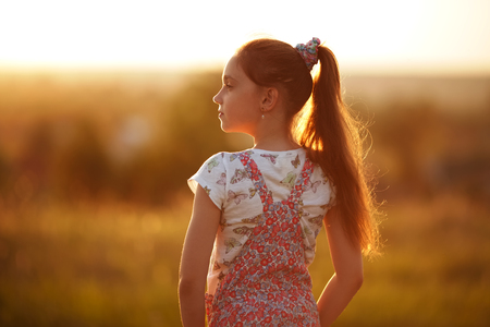 blessedness: Longhaired little girl looks into the distance