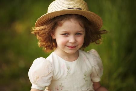 girlie: Beautiful little girl in a straw hat