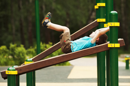 stubbornness: Little boy exercise on the playground in summer