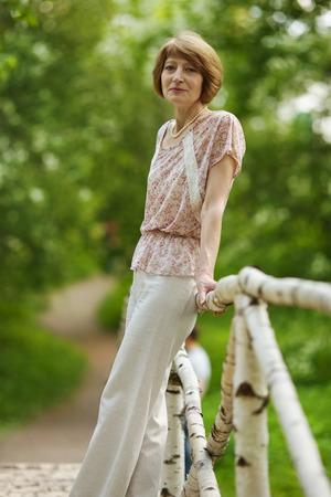womanhood: Beautiful elderly woman in the summer park