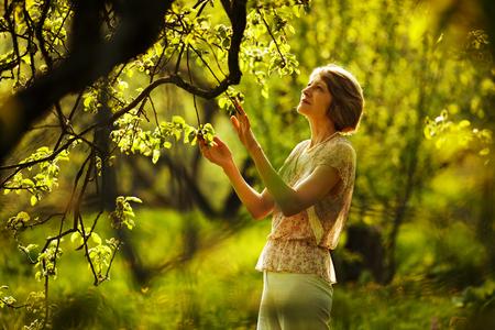 beatitude: Beautiful older woman in the summer garden Stock Photo