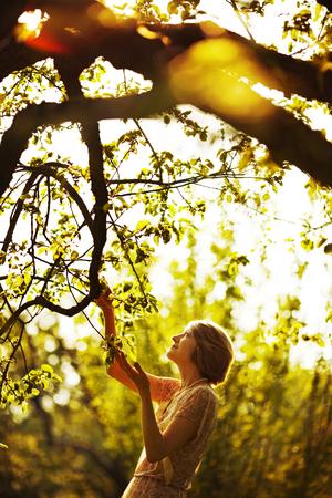 beatitude: Woman among the foliage in summer garden