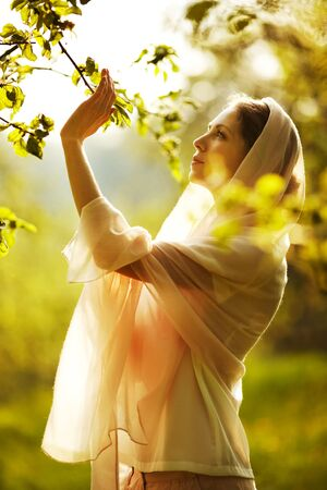 beatitude: Happy woman in a summer sunny garden