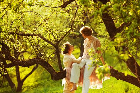 blessedness: Loving mother with her daughter in the garden