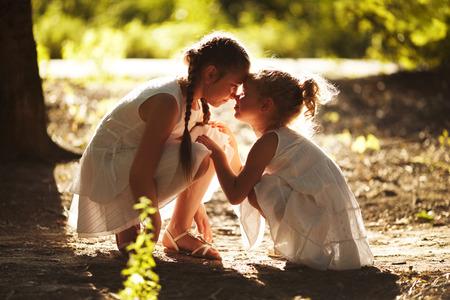 girl in nature: Happy girl girlfriend sitting in the sun