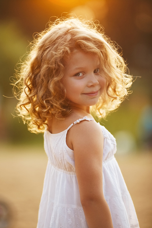 Portrait of a happy little curly girl