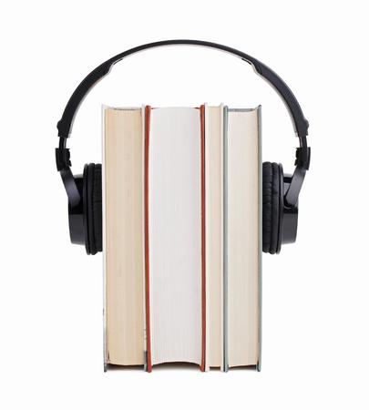 decibels: Black headphones put on a few books Stock Photo