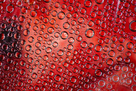 plurality: Plurality of transparent bubbles on a red background Stock Photo