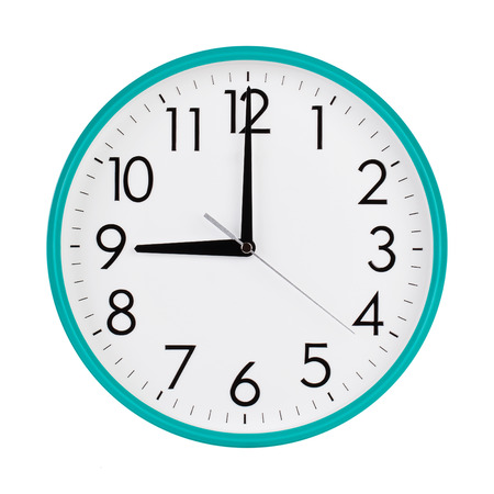 12 hour: Exactly nine hours on a round dial Stock Photo