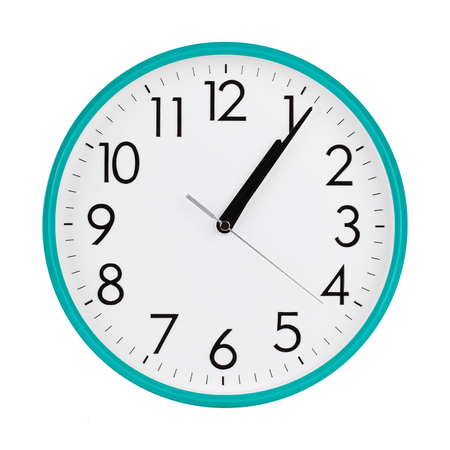 Five minutes past one on the round dial Stock Photo