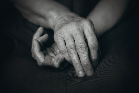 senescence: Old hands of elderly man on his knees