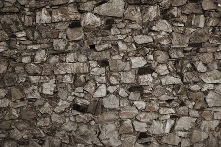 foundation cracks: Ancient wall built of different shapes bricks Stock Photo