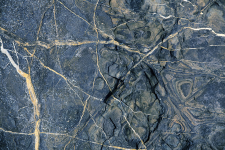 hardwearing: Reddish brown stone with cracks and stains on the surface Stock Photo
