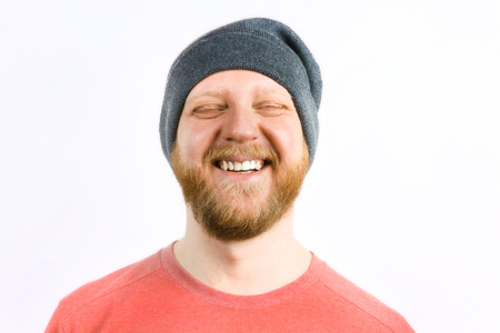 bloke: Happy cheerful guy in a knitted cap Stock Photo