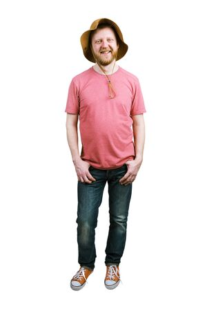 bloke: Funny happy bearded man in a panama hat and jeans Stock Photo
