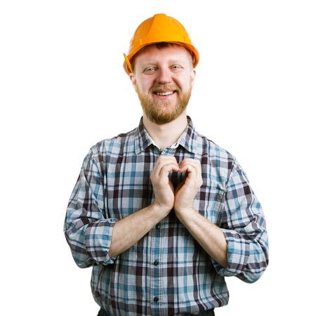 friendliness: Hombre en un casco anaranjado que muestra el corazón manos