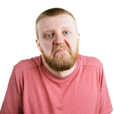skepticism: Bearded man in a pink shirt shrugs Stock Photo