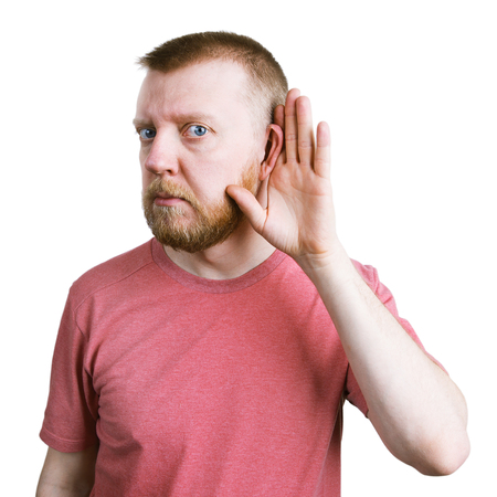 bloke: Man with a red beard is listening to something Stock Photo
