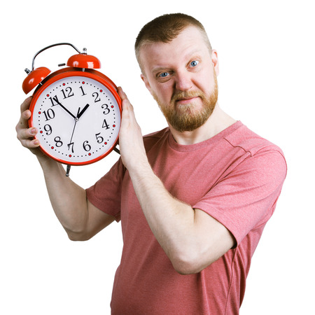 exasperation: Resents bearded man with a red alarm clock