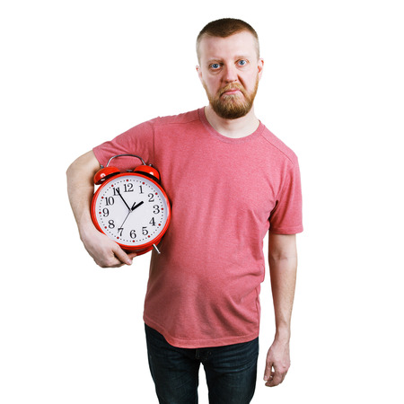 exasperation: Unhappy man with an alarm clock in hands Stock Photo
