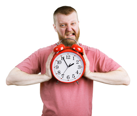 bloke: Angry man trying to break a big alarm clock