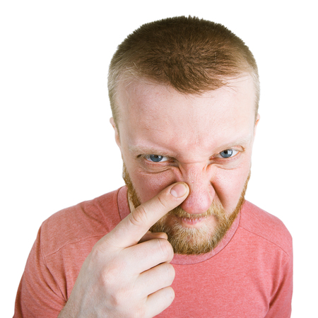 bloke: Unhappy bearded man pointing at a pimple on his nose Stock Photo