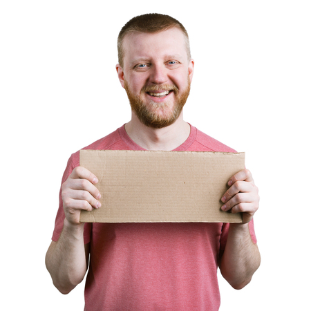bloke: Funny bearded man with a cardboard sign in his hand