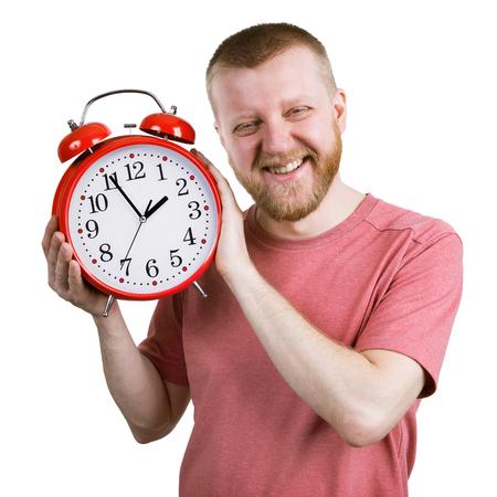 funny bearded man: Funny bearded man with a red alarm clock Stock Photo