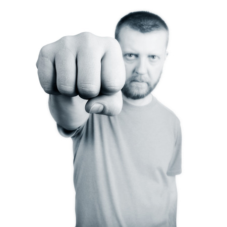 disrespect: Bearded man held out his hand with fist Stock Photo
