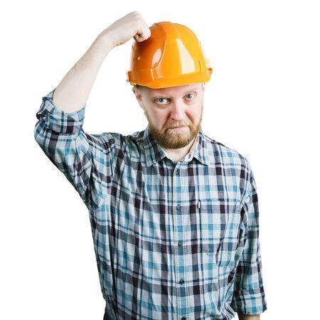 bangs: Bearded man bangs his hand on protective helmet Stock Photo