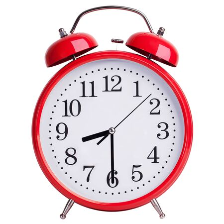 ninth: Red alarm clock shows half of the ninth Stock Photo