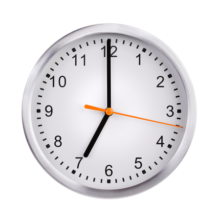 seven o'clock: Round the clock shows exactly seven oclock Stock Photo