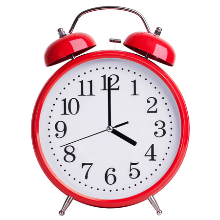 12 hour: Round red alarm clock shows exactly four