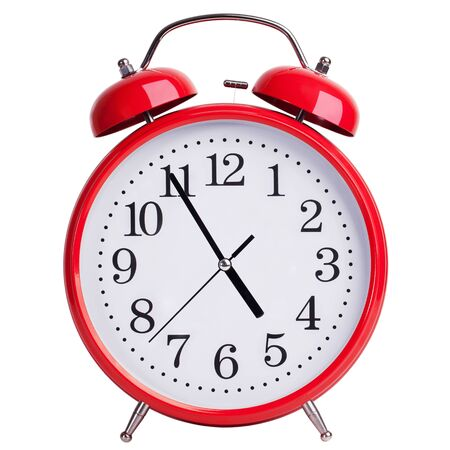 peal: Round red alarm clock showing almost five