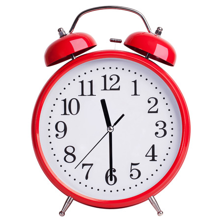 12 hour: Round red alarm clock shows half past eleven Stock Photo