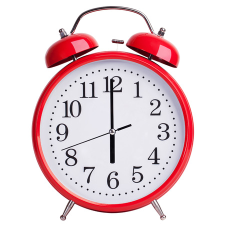 12 hour: Round red alarm clock shows exactly sixl