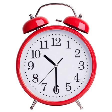 peal: Red round alarm clock shows half past ten
