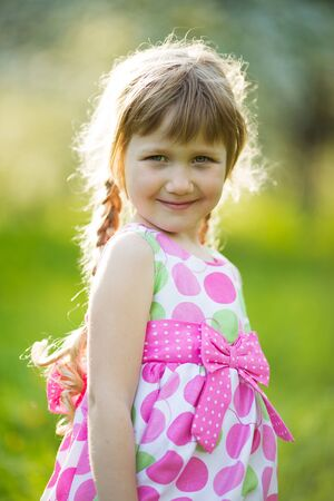 summer dress: Little happy girl in colored summer dress