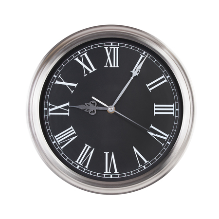 nine: Five minutes past nine on a round clock face Stock Photo