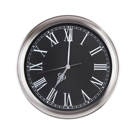 12 hour: Round clock shows exactly seven oclock Stock Photo