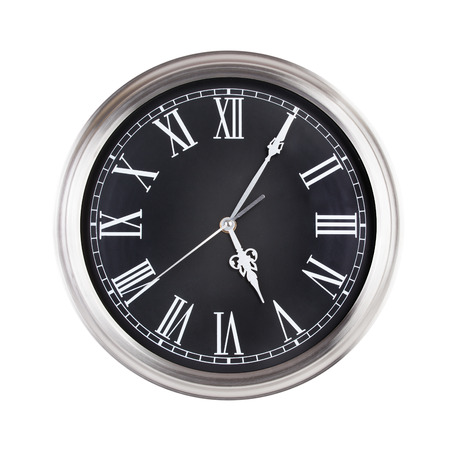 minutes: Five minutes past five on the round  clock Stock Photo