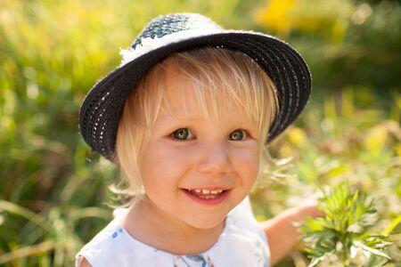 honey blonde: Little blonde girl in stylish blue hat