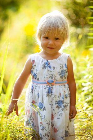 honey blonde: Little blonde girl in a summer dress