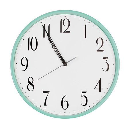 minutes: Five minutes to eleven on round clock