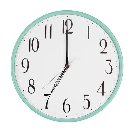 seven o'clock: Round clock shows exactly seven oclock Stock Photo