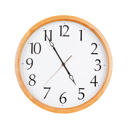 12 hour: Almost five oclock on a large round clock